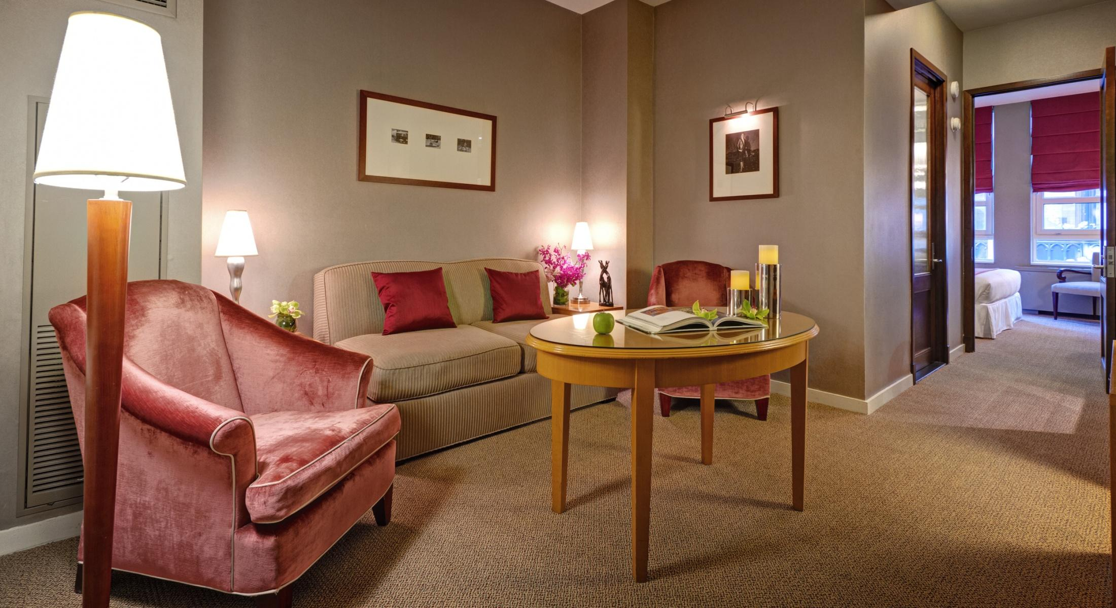 The living room in our Classic King Suite offers a tranquil space for you to relax during your visit to Hotel Giraffe