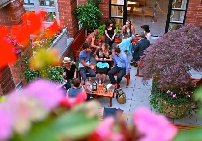 In the warmer months, Hotel Giraffe's Rooftop Garden transforms into a casual rooftop bar.