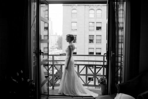 Beautiful bride overlooking Park Avenue South from a Balcony King Guestroom. Photo courtesy of Jennifer Davis Photography