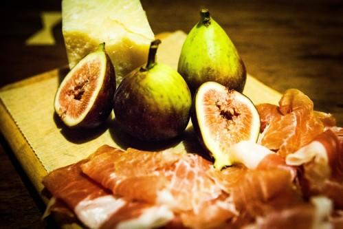 Enjoy a selection of cheeses & cured meats accompanied with fresh figs at Bread & Tulips