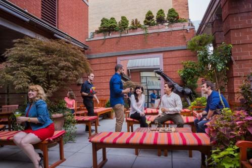 Relax and enjoy the quaint Rooftop Garden on the 12th floor of Hotel Giraffe. It even opens for cocktails during the summertime!