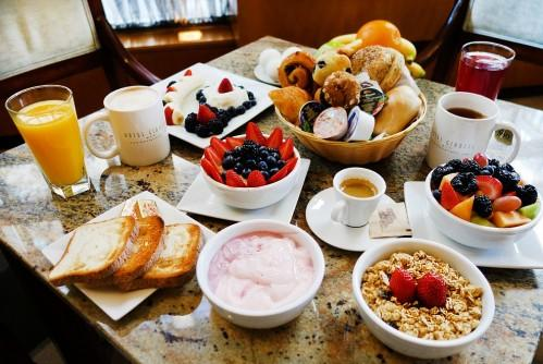 Continental breakfast at Hotel Giraffe includes oatmeal with berries, hard-boiled eggs, yogurts, fresh fruit salad and whole fruit, Danishes, bagels and a variety of spreads, a selection of juices, coffee, and teas.