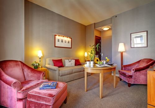 The living room of our Two Bedroom Suite has a full size sleeper sofa suitable for a 1 child or 1 young adult.