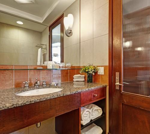 All of our guestroom bathrooms have plenty of counter space for your toiletries, and a lighted make-up mirror!