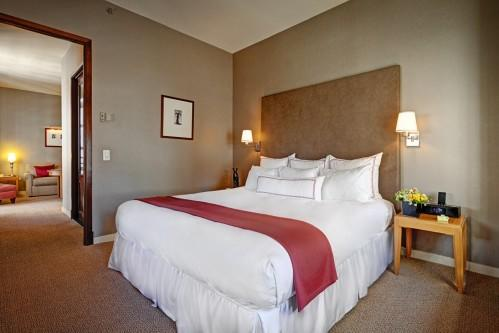 The bedroom area of the One Bedroom Suite offers a King Size Bed. Enjoy a serene evening of rest!